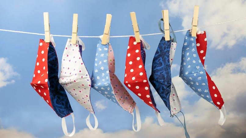 Masques en tissu : ils peuvent être portés une journée et lavés à moins de 60°C