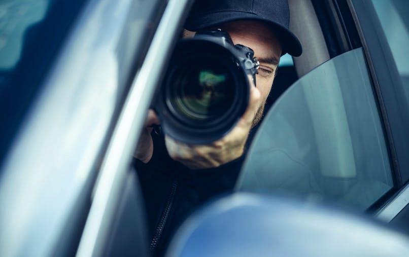 Voiture, photographe, téléobjectif