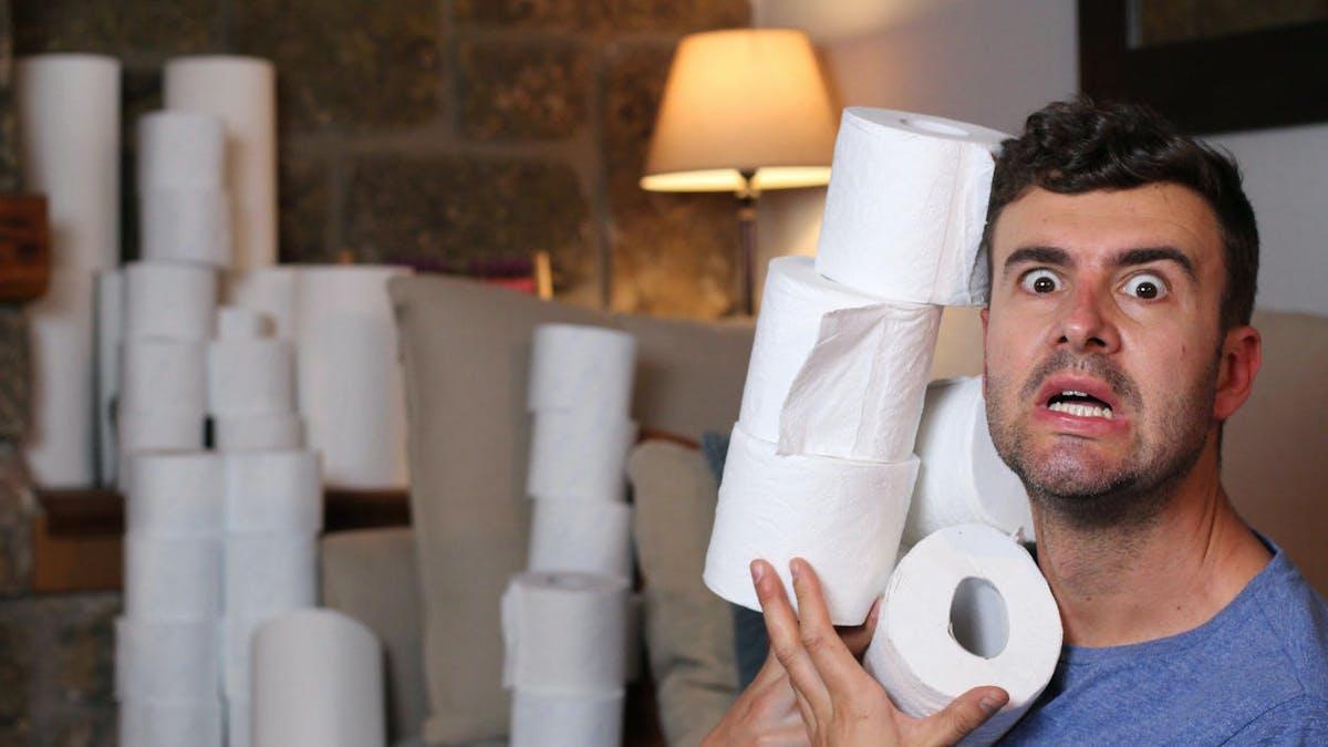Papier toilette, stocks, homme inquiet